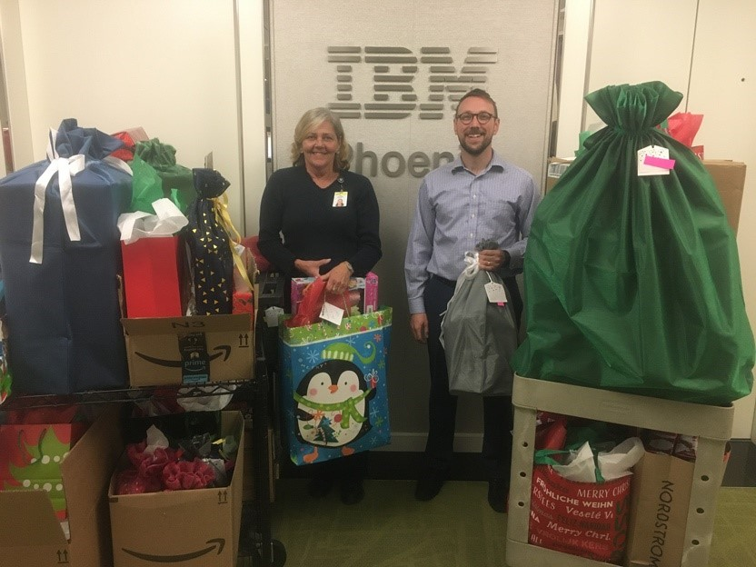 IBM employees pose with gifts they collected for this years Giving Tree Program.