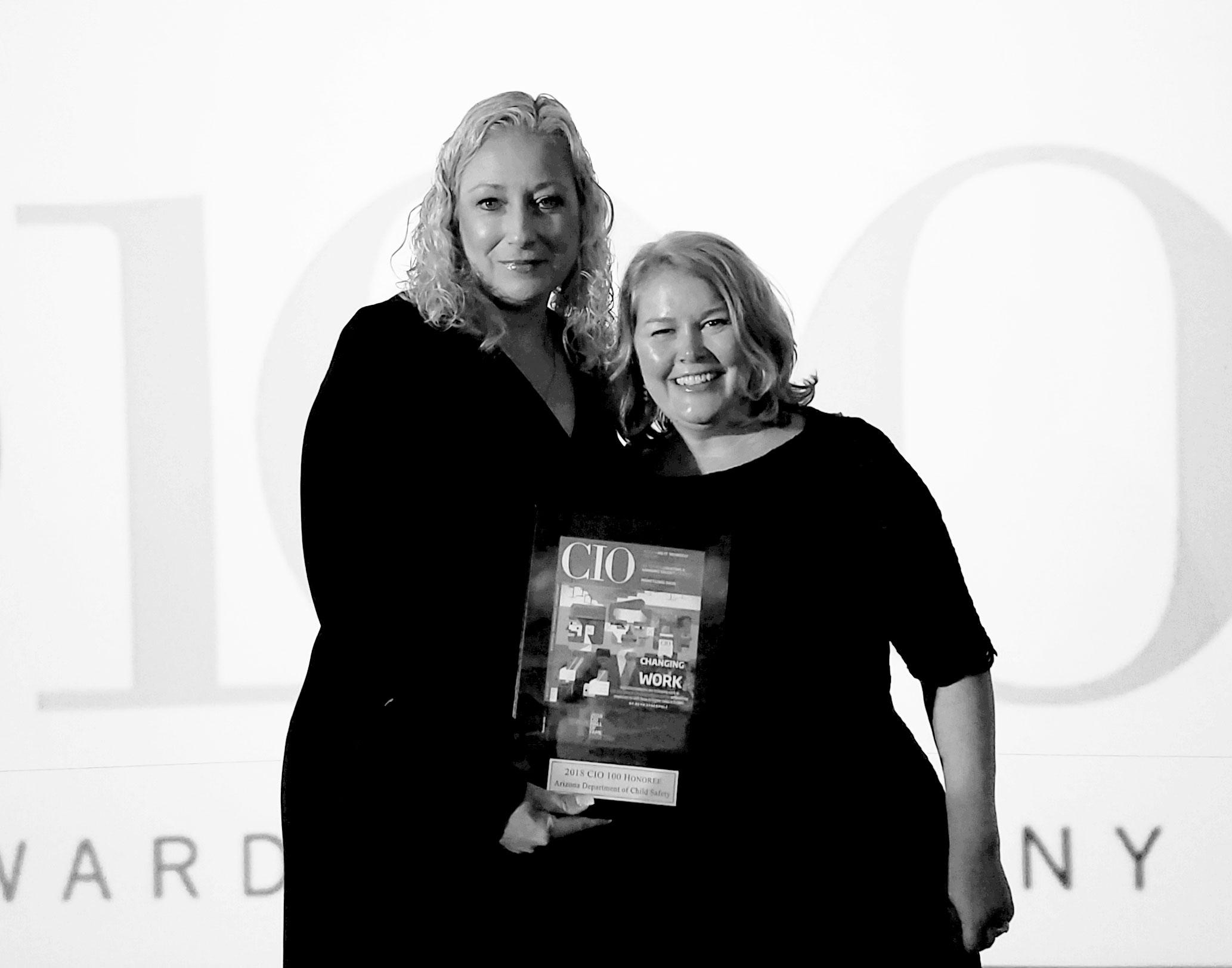 DCS Deputy Director Shalom Jacobs and DCS CIO Linda Jewell receive the CIO 100 Award